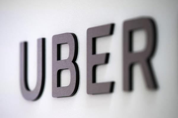 Uber logo before Uber IPO conflict with driver pay