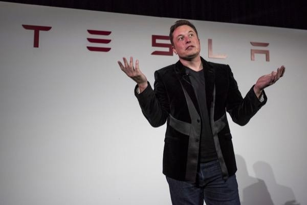 Tesla share price on watch as company changes Bitcoin policy